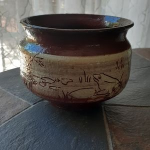 Handmade ceramic bowl with frogs